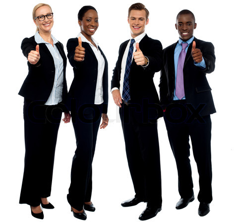 Corporate team gesturing thumbs up